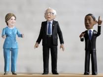 A Bernie Sanders action figure prototype is displayed with Hillary Clinton and Barak Obama figures in a photo illustration taken in the Brooklyn borough of New York