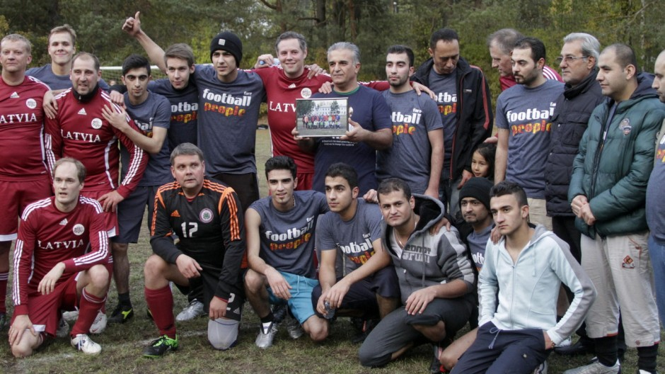 Refugees, MPs play soccer in Latvia