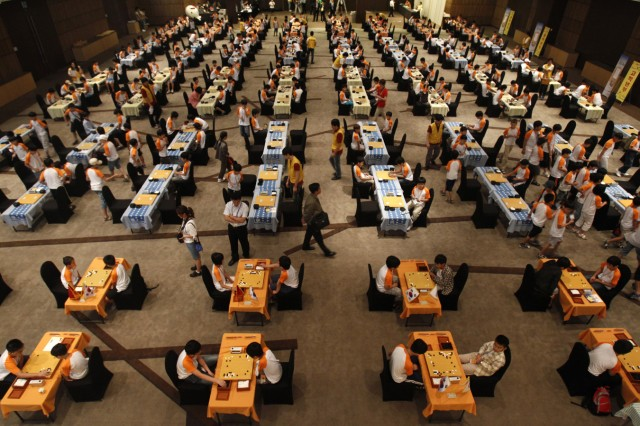 Children play 'Go', a board game known as Baduk in Korean, during the final round of the 11th World Youth Baduk Championship in Seoul