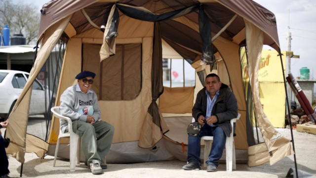 Jose Luis Gonzalez Meza sits outside a tent before starting a hunger strike in support of Joaquin Guzman, outside Altiplano Federal Penitentiary