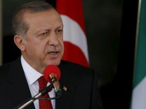 Turkish President Erdogan speaks during a news conference after meeting with Nigerian President Buhari in Abuja