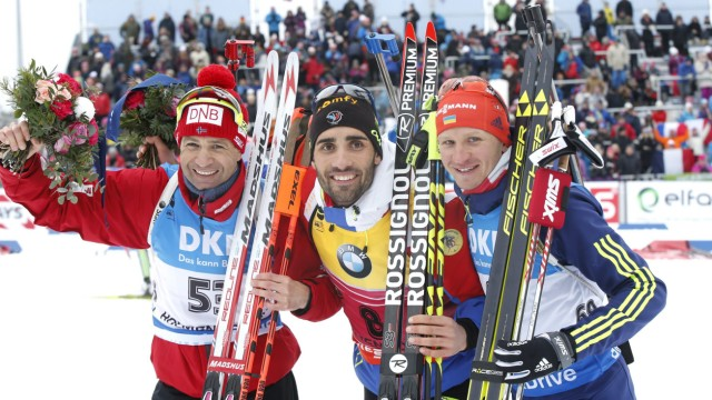 Second placed Ole Einar Bjorndalen from Norway, first placed Martin Fourcade from France and third placed Sergey Semenov from Ukraine pose after the IBU World Championships Biathlon Men Sprint in Holmenkollen Ski Arena