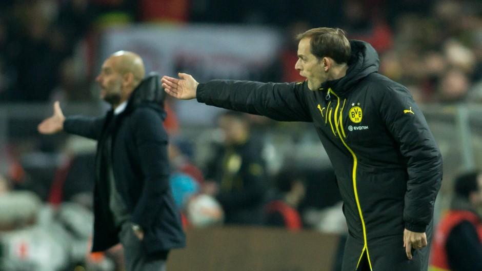 Dortmund Trainer Thomas Tuchel Borussia Dortmund und Trainer Pep Guardiola FC Bayern Muenchen be; Pep Guardiola und Thomas Tuchel
