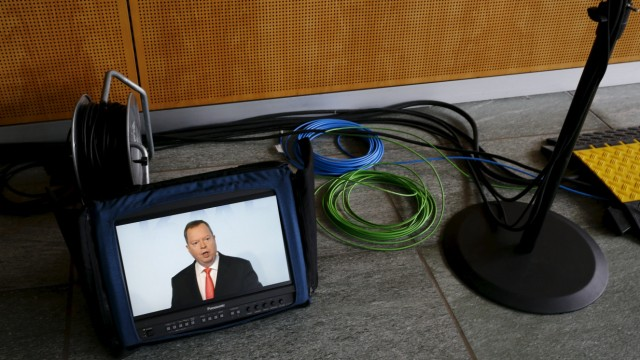 RWE CEO Terium is seen on a monitor during annual financial results news conference in Essen