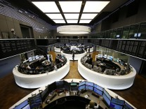 The German share prize index board and the trading room of Frankfurt's stock exchange are photographed during afternoon trading session in Frankfurt