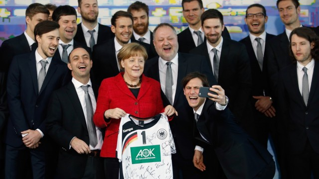 Federal Chancellor Angela Merkel Welcomes National Handball Team