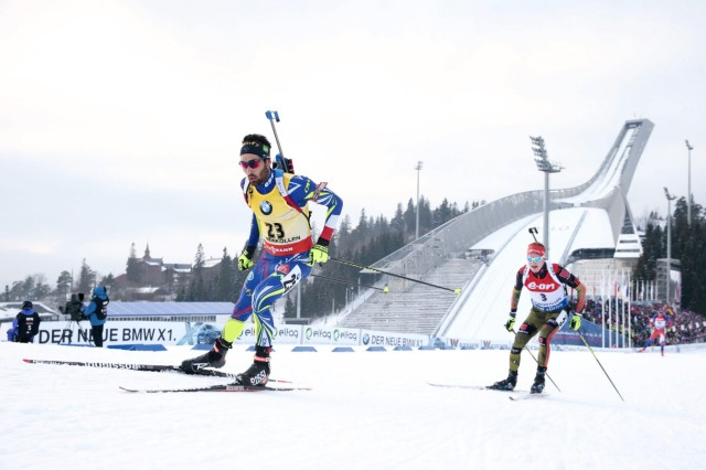Martin Fourcade of France and Benedikt Doll of Germnay competes in IBU World Championships Biathlon: Men Individual 20 km at Holmenkollen Ski Arena
