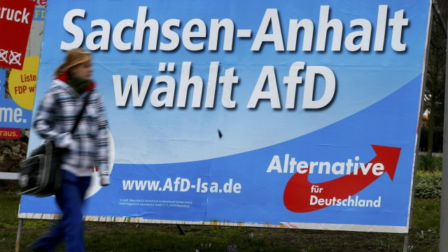 Pedestrian walks in front of an election poster for right-wing AFD in Magdeburg