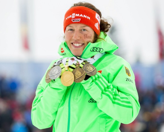 Laura Dahlmeier of Germany shows her medals after the Women's 12.5km Mass Start Competition of the IBU World Championships Biathlon at Holmenkollen Ski Arena, Oslo, Norway