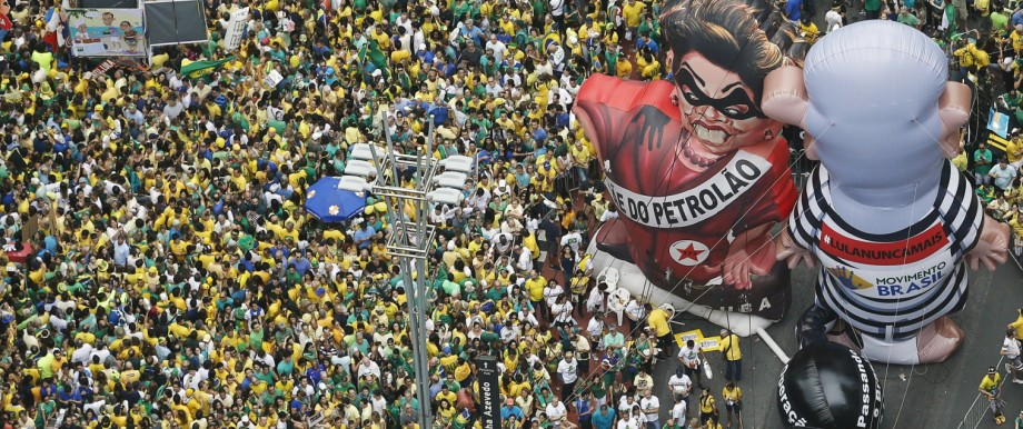 Inflatable dolls known as 'Pixuleco' of Brazil's former President Luiz Lula da Silva and Brazil's President Rousseff are seen during a protest against Rousseff, part of nationwide protests calling for her impeachment, in Sao Paulo