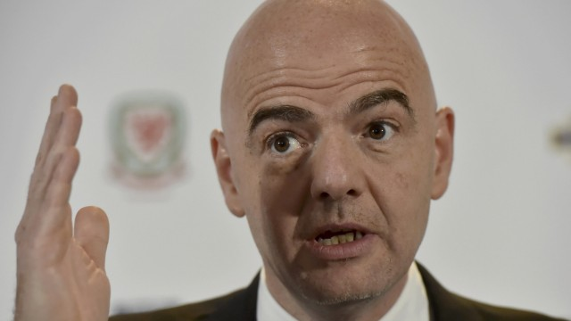 Newly elected FIFA President Gianni Infantino attends a news conference during the 130th Annual General Meeting of the International Football Association Board, in Cardiff, Britain