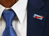 A badge of AfD is seen on the jacket of Junge, candidate of the anti-immigration party Alternative for Germany in Rhineland-Palatinate at a news conference in Berlin