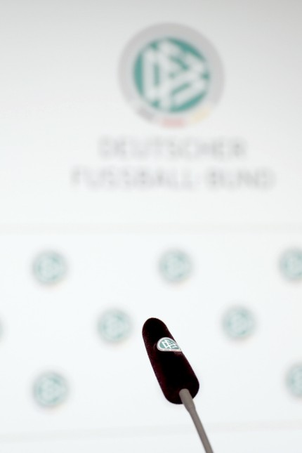 A microphone with a German Football Association logo upon it stands on a table prior to a DFB news conference in Frankfurt