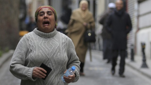 A woman reacts following a suicide bombing in central Istanbul