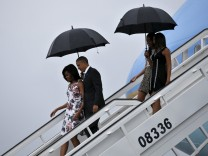 U.S. President Barack Obama and his wife Michelle exit Air Force One as they arrive at Havana's international airport for a three-day trip, in Havana