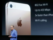 Apple Vice President Greg Joswiak introduces the iPhone SE during an event at the Apple headquarters in Cupertino, California