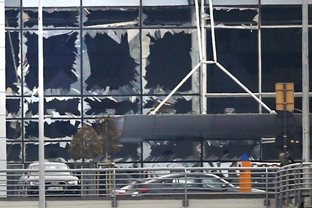 Broken windows seen at the scene of explosions at Zaventem airport near Brussels, Belgium