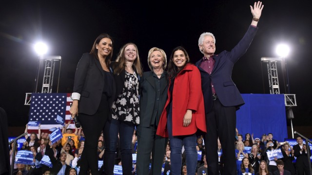 Eva Longoria, Chelsea Clinton, U.S. Democratic presidential candidate Hillary Clinton, America Ferrera and former President Bill Clinton wave to supporters before Hillary Clinton spoke at a campaign rally at the Clark County Government Center in Las