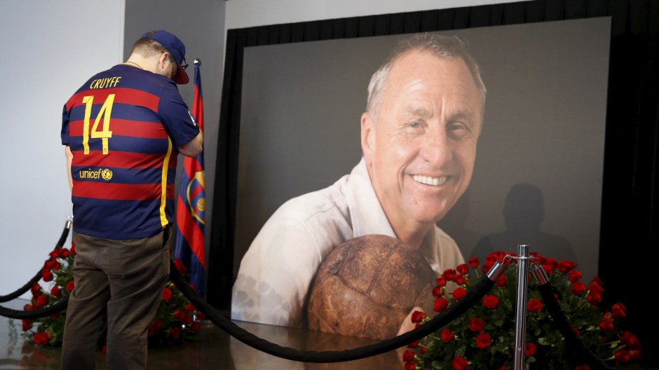 A man cries in front of a picture of Johan Cruyff during a memorial at Camp Nou stadium in Barcelona