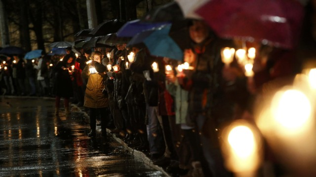 Participants hold candles during a protest against LEGIDA, the Leipzig arm of the anti-Islam movement PEGIDA, in Leipzig