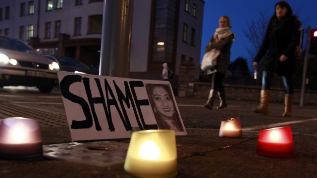 A candlelit vigil is held outside University Hospital Galway in Galway