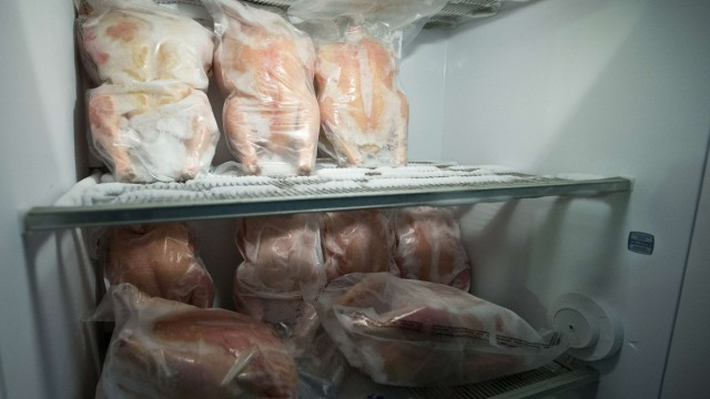 Chickens are seen in one of two freezers at the Nice family farm in Kinston