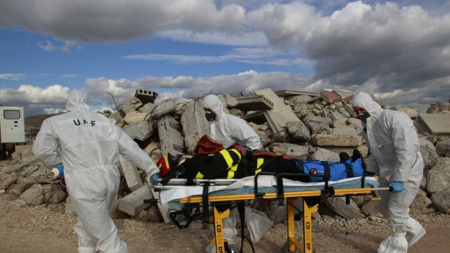 Emergency workers take part in exercises during an emergency response drill to simulate the aftermath of a dirty bomb explosion outside Madrid