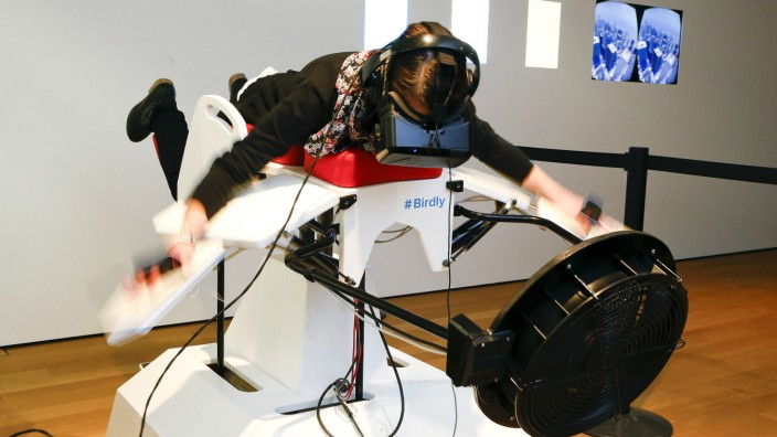 A visitor tries the flight simulator Birdly at the exhibition 'Animated Wonderworlds' at Museum fuer Gestaltung (Museum for Design) in Zurich