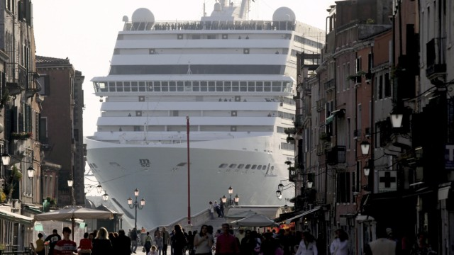 The cruise ship from Mediterranean Shipping Company Musica dwarfs Via Garibald as it arrives in Venice