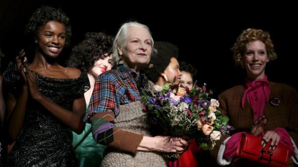 Designer Vivienne Westwood receives applause after her catwalk show at London Fashion Week Autumn/Winter 2016 in London, Britain