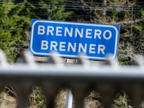 A sign reading 'Brenner - Brennero' is pictured at the train station on the Italian-Austrian borde