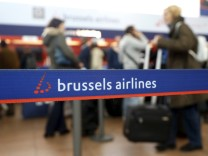File picture shows passengers queuing in front of Brussels Airlines desk at the Zaventem international airport near Brussels