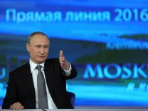 Russian President Putin attends a live broadcast nationwide call-in in Moscow