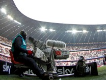 File photo of a television cameraman of SKY SPORT filming before the German Bundesliga first division soccer match between Bayern Munich and 1. FC Kaiserslautern in Munich