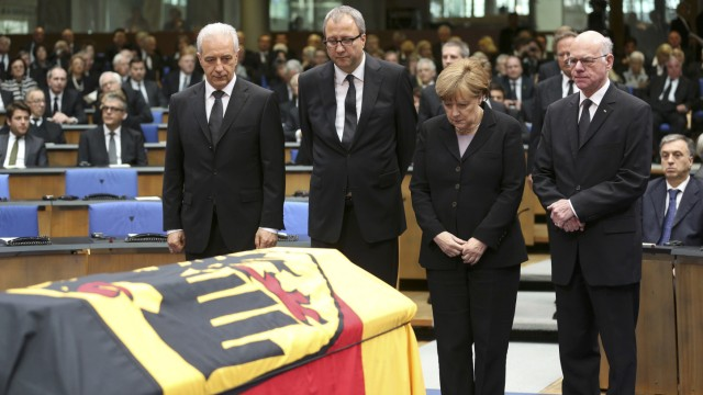 German officials pay respects during a memorial service for former West German foreign minister Genscher in the former lower house of parliament Bundestag in Bonn