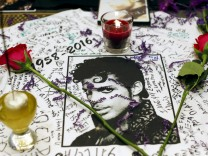 A makeshift memorial is seen as fans gather at Harlem's Apollo Theater to celebrate the life of deceased musician Prince in the Manhattan borough of New York, U.S.