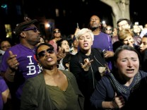People dance at a street party hosted by director Spike Lee called 'PRINCE We Love You Shockadelica Joint' to celebrate the life and music of deceased musician Prince in the Brooklyn borough of New York, U.S.