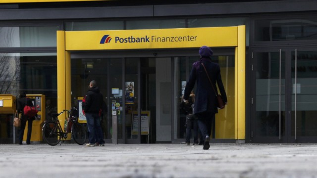 File photo of people entering a building of Deutsche Postbank AG in Berlin