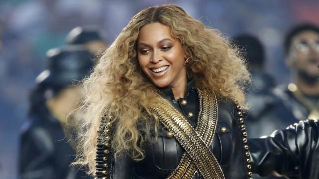 Beyonce smiles after performing during the half-time show at the NFL's Super Bowl 50 football game between the Carolina Panthers and the Denver Broncos in Santa Clara