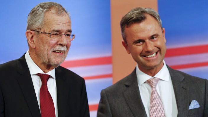 Presidential candidates van der Bellen and Hofer react during a TV debate in Vienna
