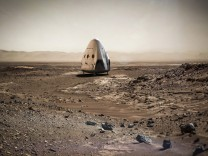Artist's concept photo of a SpaceX dragon capsule on the surface of Mars
