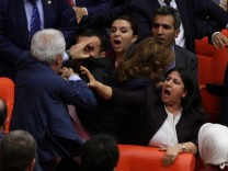 Ruling AK Party and pro-Kurdish Peoples' Democratic Party (HDP) lawmakers scuffle during a debate at the Parliament in Ankara