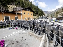 Police and activists clash at rally against border control betwee