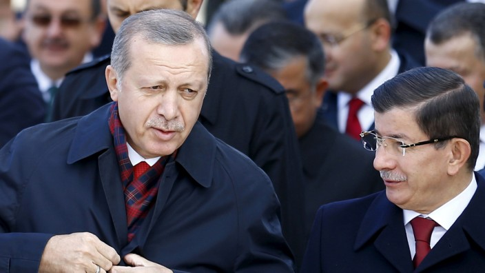 File photo of Turkey's President Erdogan chatting with Prime Minister Davutoglu during a Republic Day ceremony at Anitkabir in Ankara