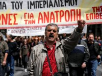 A protester shouts slogans during a protest marking a 48-hour general strike against tax and pension reforms in Athens