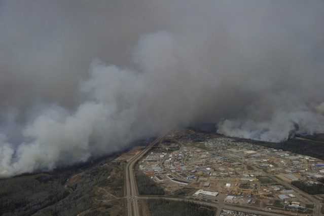 A Canadian Joint Operations Command aerial photo shows wildfires near neighborhoods in Fort McMurray Alberta Canada