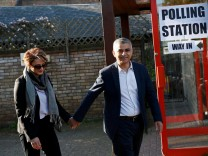 Khan, Britain's Labour Party candidate for Mayor of London and his wife Saadiya leave after casting their votes for the London mayoral elections