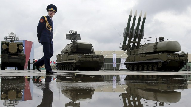 Russian serviceman walks past Buk-1M missile system at Army-2015 international military forum in Kubinka