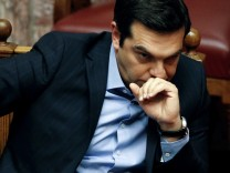 Greek PM Tsipras attends a parliamentary session before a vote of tax and pension reforms in Athens