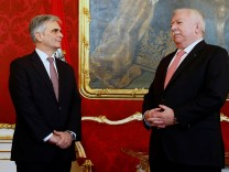 Austrian chancellor and head of the SPOe Faymann and deputy SPOe chairman Haeupl stand next to each other during Haeupl's inauguration as Vienna mayor in Vienna
